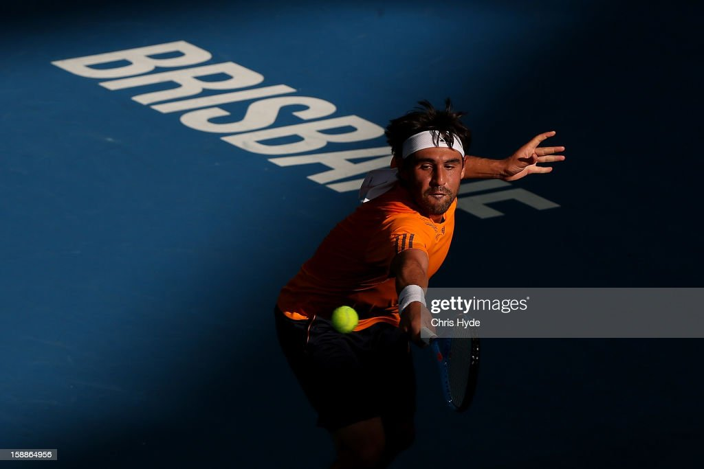 Marcos Baghdatis of Cyrpus plays a backhand during his match against Florian Mayer of Germany on day four of the Brisbane International at Pat Rafter Arena on January 2, 2013 in Brisbane, Australia.