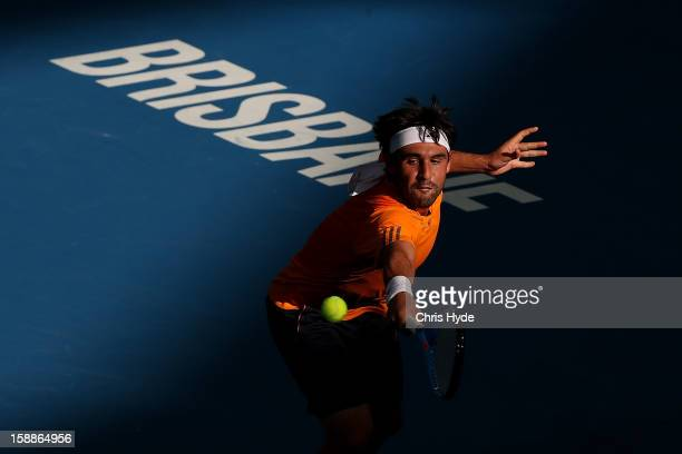 Marcos Baghdatis of Cyrpus plays a backhand during his match against Florian Mayer of Germany on day four of the Brisbane International at Pat Rafter...