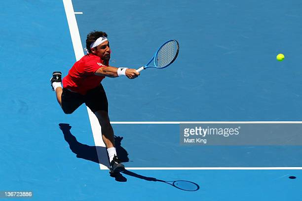 Marcos Baghdatis of Cyrpus plays a forehand in his second round match against Matthew Ebden of Australia during day four of the 2012 Sydney...