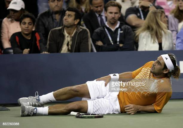 Marcos Baghdatis suffers cramp against USA's Andre Agassi during their second round match at the US Open in Flushing Meadow New York