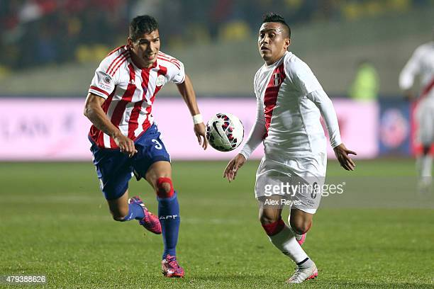 Marcos Caceres of Paraguay fights for the ball with Christian Cueva of Peru during the 2015 Copa America Chile Third Place Playoff match between Peru...