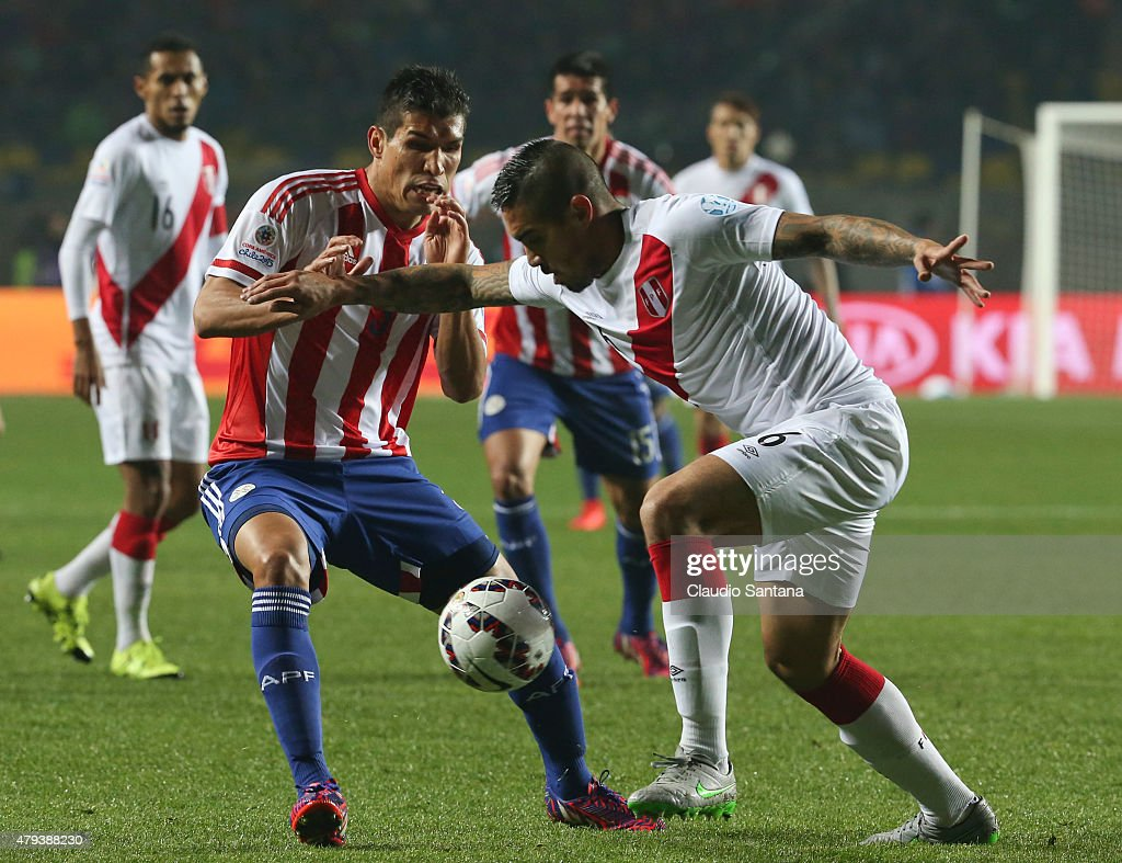 <a gi-track='captionPersonalityLinkClicked' href=/galleries/search?phrase=Marcos+Caceres&family=editorial&specificpeople=4480752 ng-click='$event.stopPropagation()'>Marcos Caceres</a> of Paraguay fights for the ball with <a gi-track='captionPersonalityLinkClicked' href=/galleries/search?phrase=Juan+Vargas+-+Soccer+Player&family=editorial&specificpeople=4167791 ng-click='$event.stopPropagation()'>Juan Vargas</a> of Peru during the 2015 Copa America Chile Third Place Playoff match between Peru and Paraguay at Ester Roa Rebolledo Stadium on July 03, 2015 in Concepcion, Chile.