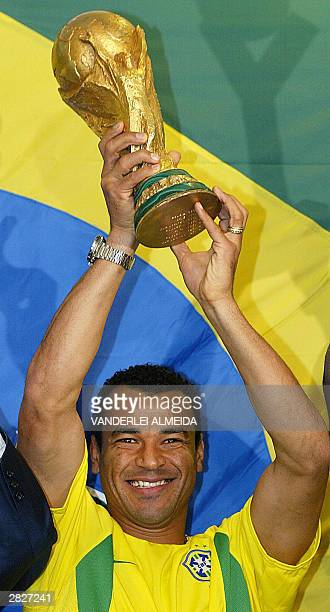 Marcos Cafu captain of the Brazilian National soccer team holds the trophy of the FIFA World Cup KoreaJapan 2002 in Rio de Janeiro 22 December 2003...