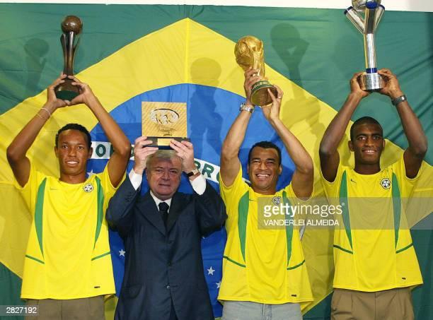 Marcos Cafu captain of the Brazilian National soccer team Jose Adailton captain of Under20 team Joao Guilherme captain of Under17 team hold the...
