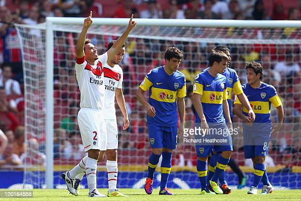 Marcos Ceara of Paris St Germain raises his arms in celebration after scoring from a free kick during the Emirates Cup match between Boca Juniors and...