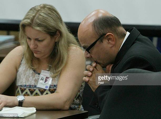 Marcos Costa listens to court appointed interpreter Teresa Krakow as she explains why the jury was sent back to the jury room to deliberate on the...
