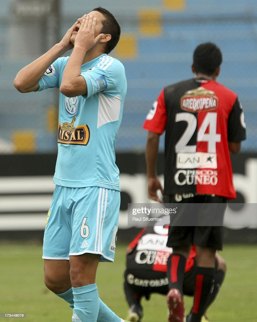 Marcos Delgado (L) of Sporting Cristal reacts during a match between Sporting Cristal and Melgar FC as part of the Torneo Descentralizado 2013 at Alberto Gallardo Stadium on July 14, 2013 in Lima, Peru.