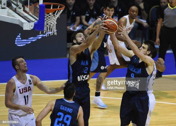 Marcos Delia and Nicolas Brussino of Argentina fight for the ball during the FIBA Americup final match between US and Argentina at Orfeo Superdomo...