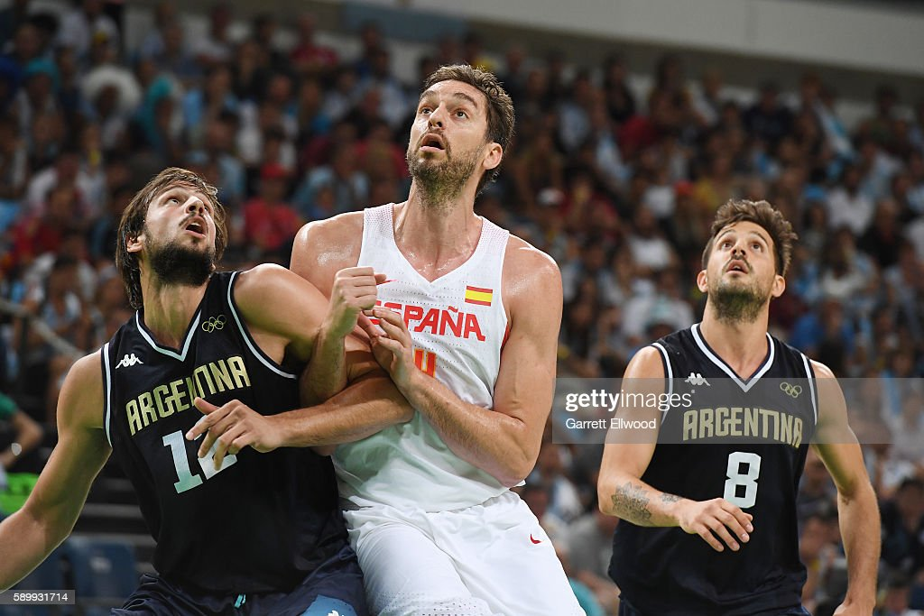 Marcos Delia and Nicolas Laprovittola of Argentina box out against Pau Gasol of Spain on Day 10 of the Rio 2016 Olympic Games at Carioca Arena 1 on...