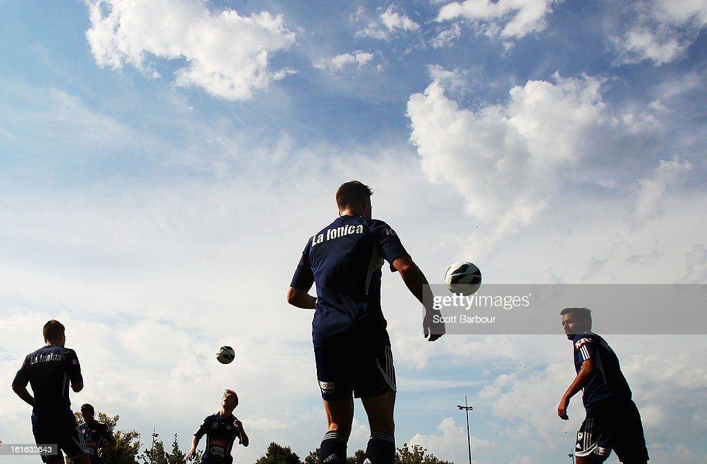 Marcos Flores (R) and his Victory team mates control the ball during a Melbourne Victory A-League training session at Gosch's Paddock on February 14, 2013 in Melbourne, Australia.
