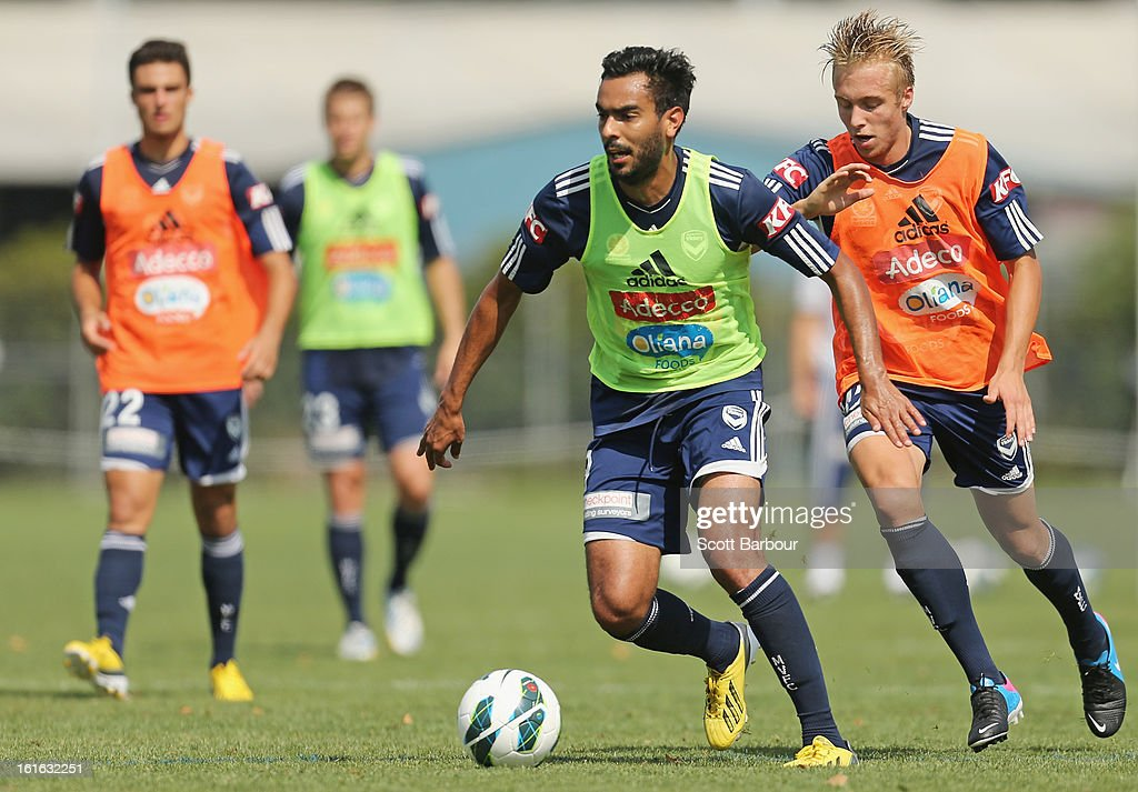 Marcos Flores and James Jeggo of the Victory compete for the ball during a Melbourne Victory A-League training session at Gosch's Paddock on February 14, 2013 in Melbourne, Australia.