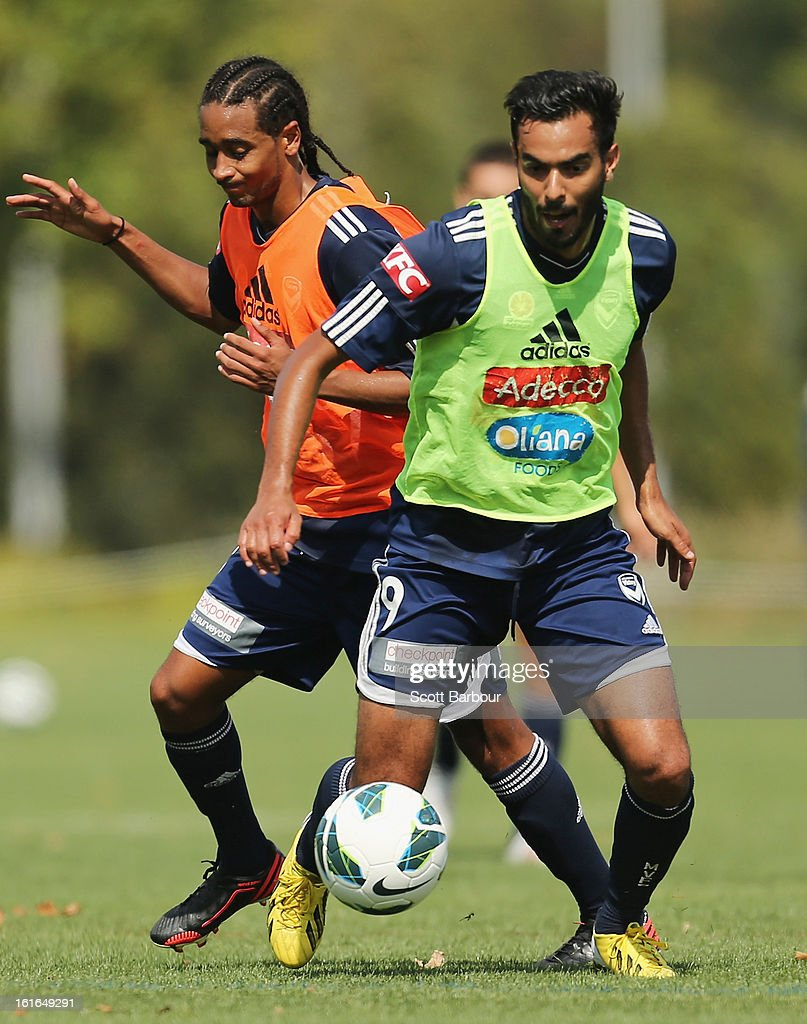 Marcos Flores and Jonathan Bru of the Victory compete for the ball during a Melbourne Victory A-League training session at Gosch's Paddock on February 14, 2013 in Melbourne, Australia.