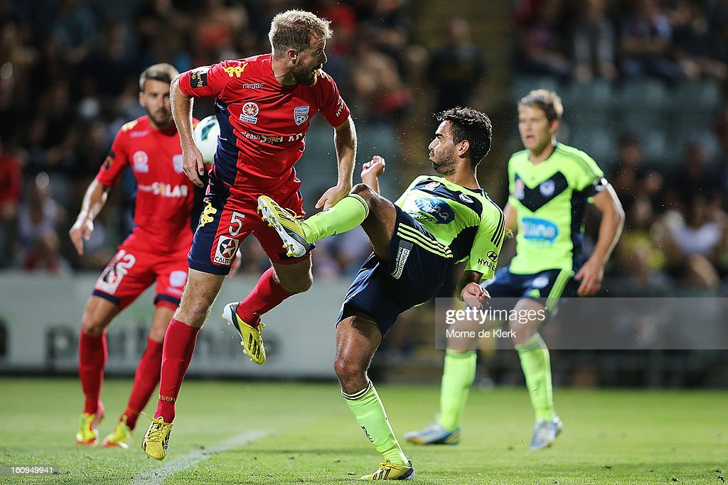 Marcos Flores of Melbourne fails to get a strike on goal as Iain Fyfe of Adelaide defends in front of goal during the round 20 A-League match between Adelaide United and the Melbourne Victory at Hindmarsh Stadium on February 8, 2013 in Adelaide, Australia.