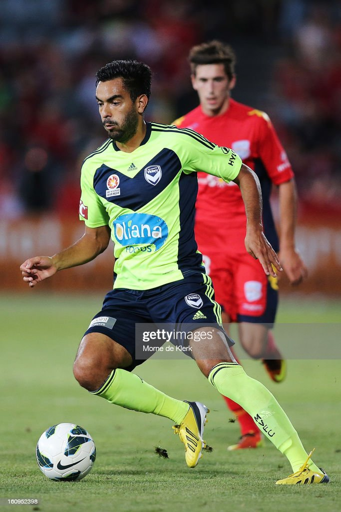 Marcos Flores of Melbourne runs with the ball during the round 20 A-League match between Adelaide United and the Melbourne Victory at Hindmarsh Stadium on February 8, 2013 in Adelaide, Australia.