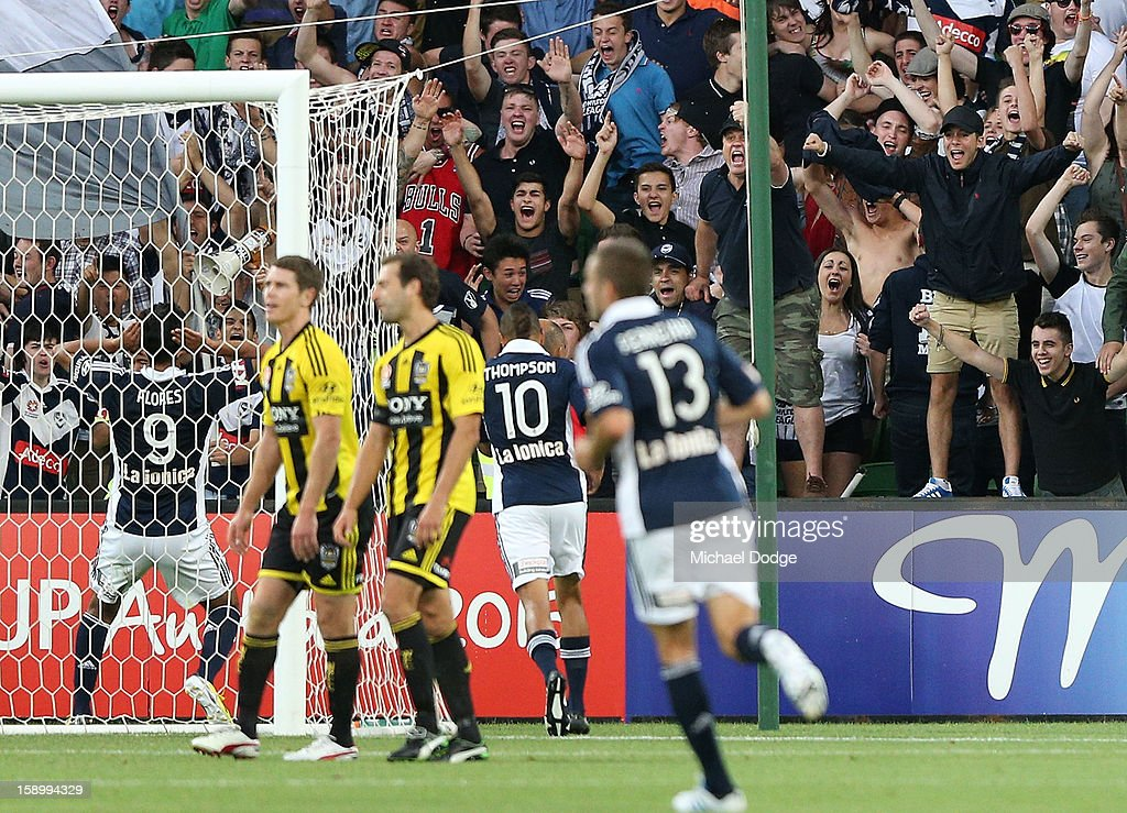 Marcos Flores of the Melbourne Victory (L) celebrates his goal with Victory fans during the round 15 A-League match between the Melbourne Victory and Wellington Phoenix at AAMI Park on January 5, 2013 in Melbourne, Australia.