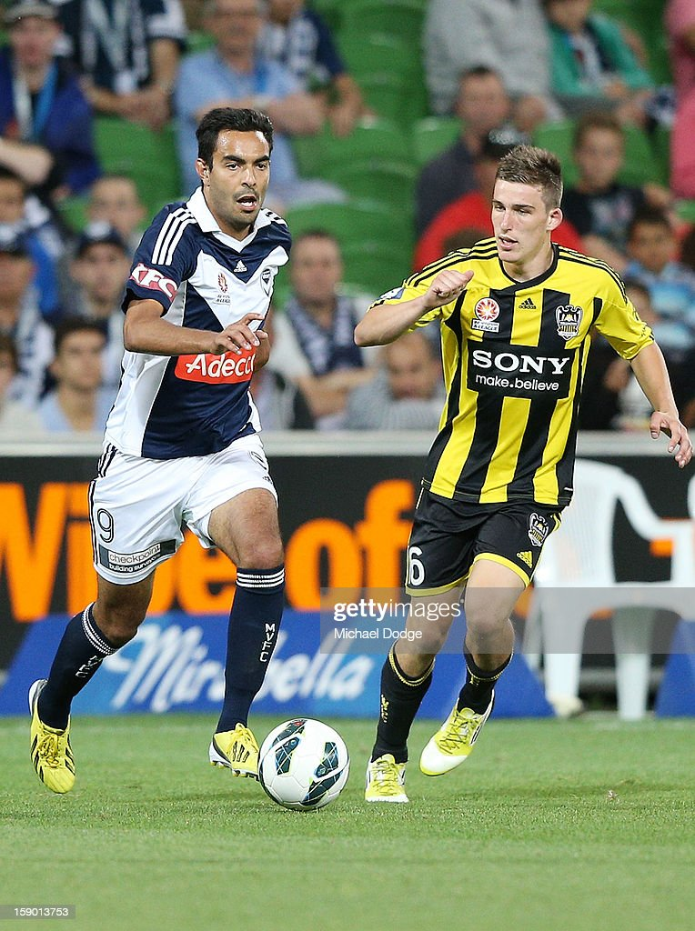 Marcos Flores of the Melbourne Victory runs with the ball during the round 15 A-League match between the Melbourne Victory and Wellington Phoenix at AAMI Park on January 5, 2013 in Melbourne, Australia.