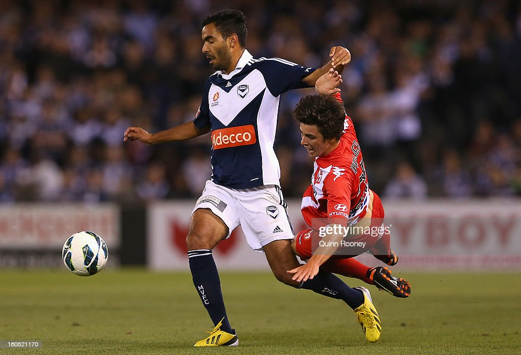 Marcos Flores of the Victory and Jeremy Walker of the Heart contest for the ball during the round 19 A-League match between the Melbourne Victory and the Melbourne Heart at Etihad Stadium on February 2, 2013 in Melbourne, Australia.