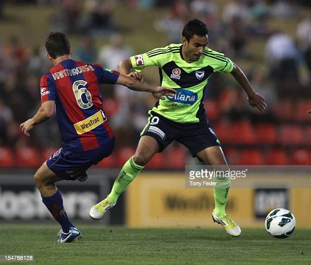 Marcos Flores of the Victory breaks clear with the ball from Ben Kantarovski of the Jets during the round four ALeague match between the Newcastle...