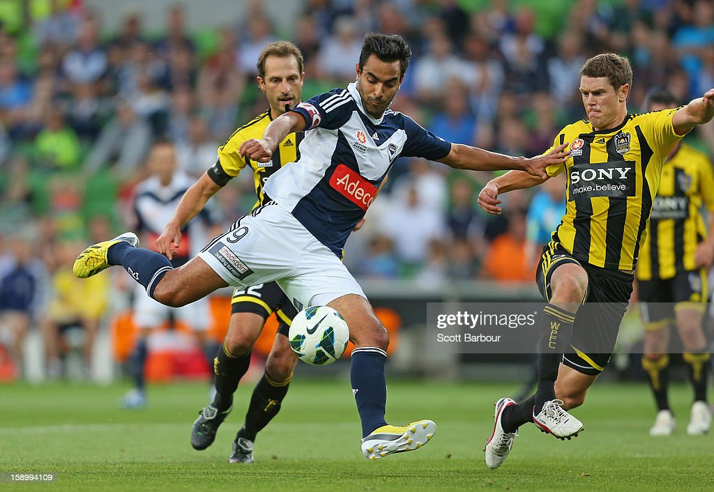 Marcos Flores of the Victory shoots and scores the Victorys first goal during the round 15 A-League match between the Melbourne Victory and Wellington Phoenix at AAMI Park on January 5, 2013 in Melbourne, Australia.