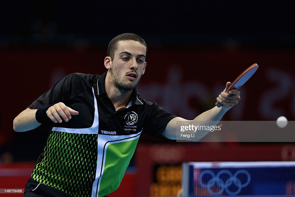 Marcos Freitas of Portugal competes during Men's Team Table Tennis first round match against team of Great Britain on Day 7 of the London 2012 Olympic Games at ExCeL on August 3, 2012 in London, England.