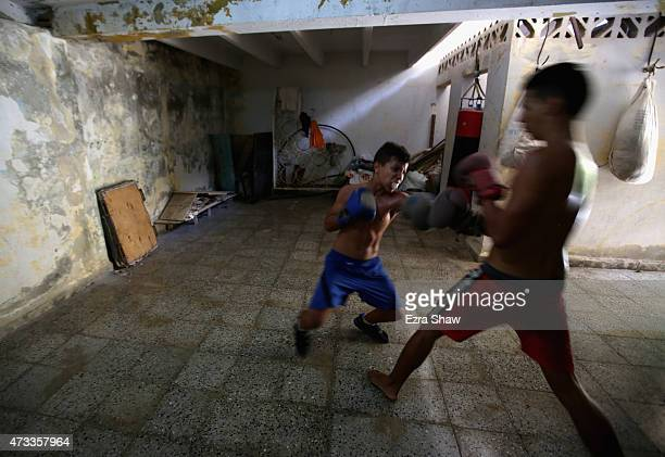 Marcos Gabriel 12yearsold and Jaime Poradius 16yearsold box each other at the Salvador Allende Sports Complex on May 9 2015 in Alamar Cuba Alamar is...