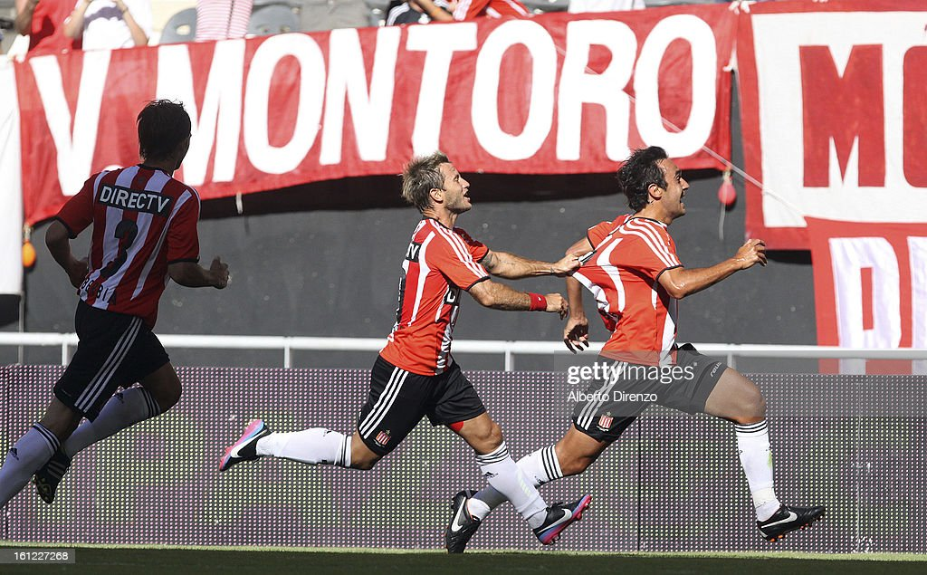 Marcos Gelabert celebrates a goal with <a gi-track='captionPersonalityLinkClicked' href=/galleries/search?phrase=Gaston+Fernandez&family=editorial&specificpeople=675705 ng-click='$event.stopPropagation()'>Gaston Fernandez</a> during a match between Estudiantes and Tigre as part of the 2013 Final Tournament on February 9, 2013 in La Plata, Argentina.