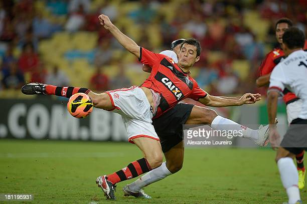Marcos Gonzalez of Flamengo fights for the ball with Luiz Antonio of Atletico Paranaense during the match between Flamengo and Atletico Paranaense...