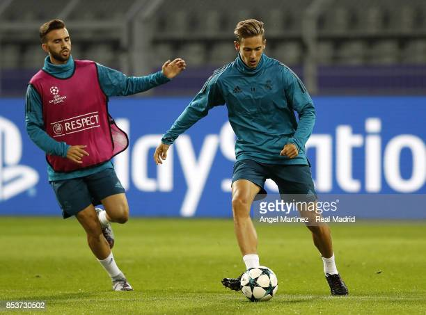 Marcos Llorente and Borja Mayoral of Real Madrid in action during a training session at Signal Iduna Park on September 25 2017 in Dortmund Germany