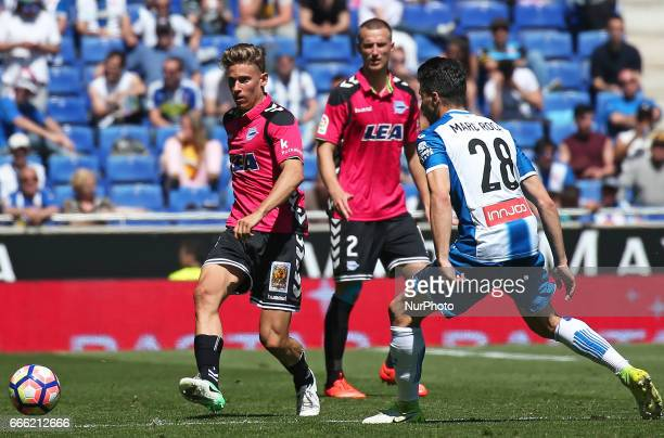 Marcos Llorente and Marc Roca during the match between RCD Espanyol and Deportivo Alaves on April 08 2017