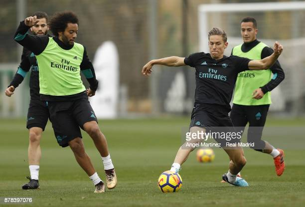 Marcos Llorente and Marcelo of Real Madrid in action during a training session at Valdebebas training ground on November 24 2017 in Madrid Spain