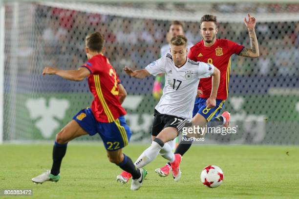 Marcos Llorente Mitchell Weiser Saul Niguez during the UEFA U21 Final match between Germany and Spain at Krakow Stadium on June 30 2017 in Krakow...