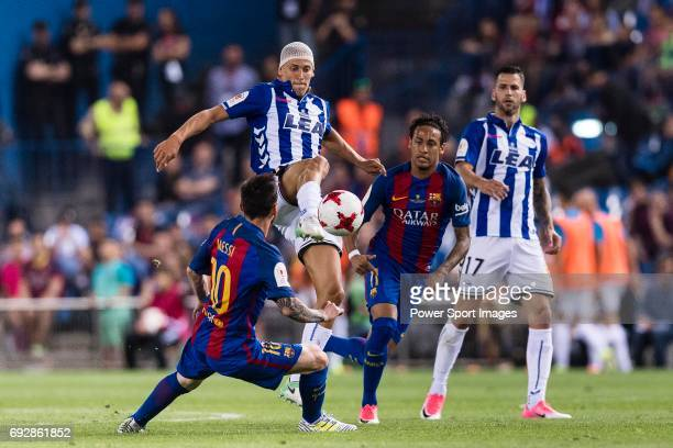 Marcos Llorente of Deportivo Alaves fights for the ball with Lionel Andres Messi of FC Barcelona during the Copa Del Rey Final between FC Barcelona...