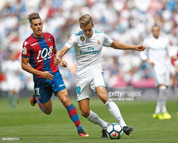 Marcos Llorente of Real Madrid and Jose Luis Morales of Levante compete for the ball during the match at Real Madrid Levante at Estadio Santiago...