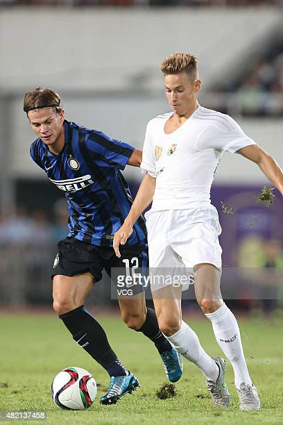 Marcos Llorente of Real Madrid and Samuele Longo of Inter Milan compete for the ball during the International Champions Cup football match between...