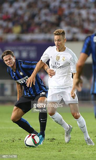 Marcos Llorente of Real Madrid competes for the ball with Longo Samuele of FC Internazionale during the match of International Champions Cup China...