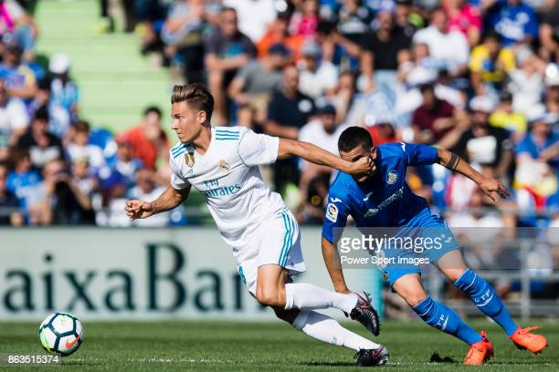Marcos Llorente of Real Madrid fights for the ball with Mauro Wilney Arambarri Rosa of Getafe CF during the La Liga 201718 match between Getafe CF...