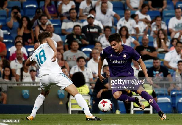 Marcos Llorente of Real Madrid in action against Ianis Hagi of Fiorentina during the Santiago Bernabeu Cup soccer match between Real Madrid and...