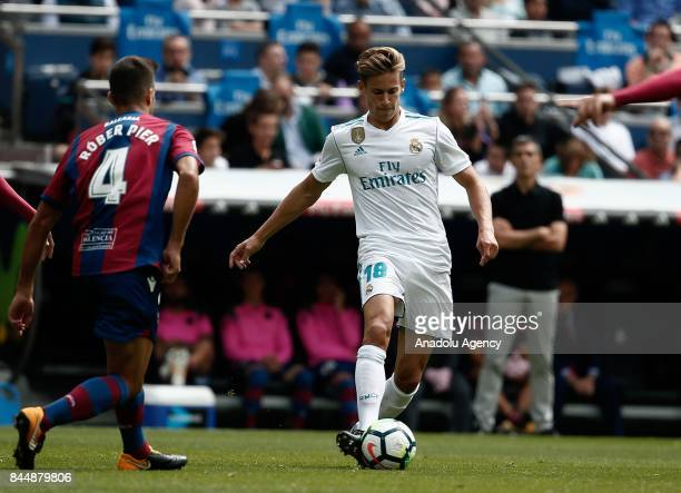 Marcos Llorente of Real Madrid in action against Rober Pier of Levante during the La Liga soccer match between Real Madrid and Levante at Santiago...