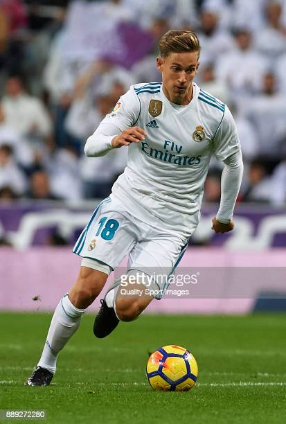 Marcos Llorente of Real Madrid runs with the ball during the La Liga match between Real Madrid and Sevilla at Estadio Santiago Bernabeu on December 9...