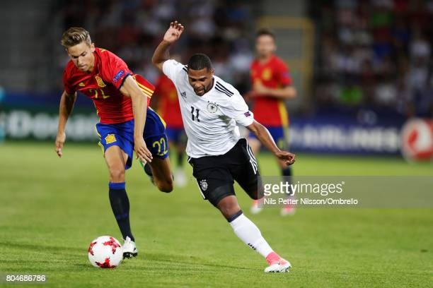 Marcos Llorente of Spain and Serge Gnabry of Germany competes for the ball during the UEFA U21 Final match between Germany and Spain at Krakow...