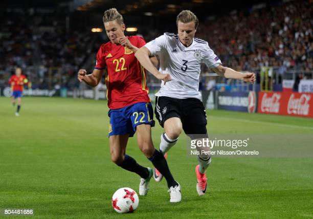 Marcos Llorente of Spain and Yannick Gerhardt of Germany in action during the UEFA European Under21 Championship Final between Germany and Spain at...