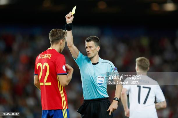 Marcos Llorente of Spain is shown a yellow card by Referee Benoit Bastien during the UEFA European Under21 Championship Final between Germany and...