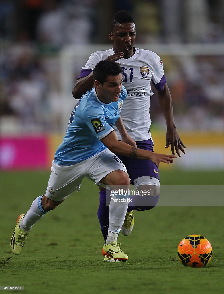 Marcos Lopes of Manchester City holds off Mahamed Noor of Al Ain during the friendly match between Al Ain and Manchester at Hazza bin Zayed Stadium on May 15, 2014 in Al Ain, United Arab Emirates.