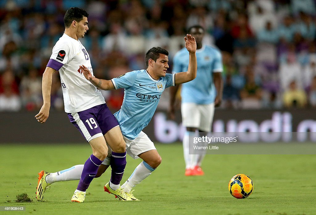Marcos Lopez of Manchester City is tackled by Mohmanad Salem of Al Ain during the friendly match between Al Ain and Manchester City at Hazza bin Zayed Stadium on May 15, 2014 in Al Ain, United Arab Emirates.