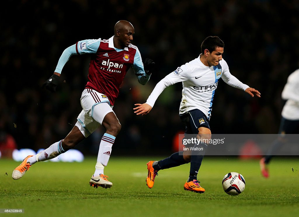 Marcos Mesquita Lopes of Manchester City is chased by <a gi-track='captionPersonalityLinkClicked' href=/galleries/search?phrase=Alou+Diarra&family=editorial&specificpeople=465019 ng-click='$event.stopPropagation()'>Alou Diarra</a> of West Ham United during the Capital One Cup Semi-Final, Second Leg match between West Ham United and Manchester City at Boleyn Ground on January 21, 2014 in London, England.