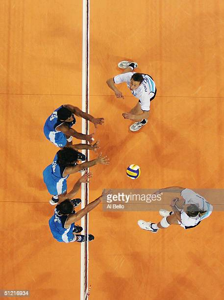 Marcos Milinkovic Argentina spikes against Italy in the men's indoor Volleyball quarterfinal match on August 25 2004 during the Athens 2004 Summer...