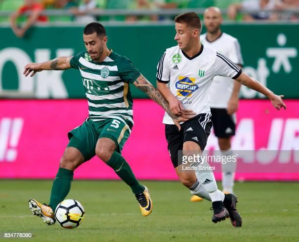 Marcos Pedroso of Ferencvarosi TC wins the ball from Bence Kiss of Swietelsky Haladas during the Hungarian OTP Bank Liga match between Ferencvarosi...