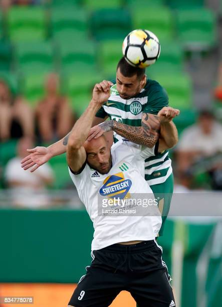 Marcos Pedroso of Ferencvarosi TC wins the ball in the air from Miroslav Grumic of Swietelsky Haladas during the Hungarian OTP Bank Liga match...