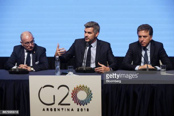 Marcos Pena Argentina's cabinet chief center speaks while Jorge Faurie Argentina's foreign affairs minister left and Nicolas Dujovne Argentina's...