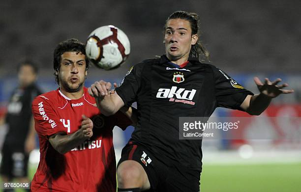 Marcos Pirchio of Deportivo Quito vies for the ball with Gonzalo Sorondo of Internacional during a match as part of the Libertadores Cup 2010 at the...